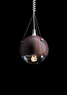 Wrecking Ball Lamp by Andrew Mitchell at Coroflot.com. Maybe in walnut?  Curly cord.