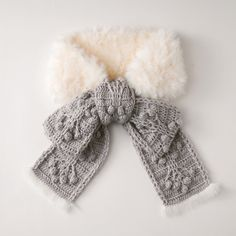 Everything is better with a bow on top, right? Crochet your own glamourous stole