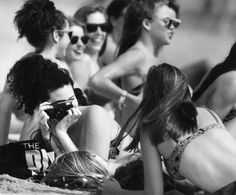 Krista Lisi of Plano East Senior High snaps a picture of her fellow classmates as they enjoy 80-degree temps on a South Padre Sunday morning in 1992. Photo: San Antonio Express-News