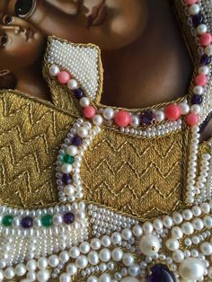 Icon frame detail (pearls, amethysts, coral beads, gold thread) Made by Larissa Borodich