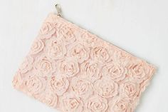 Your outfit will be coming up roses with this lovely, floral clutch bag. Pair it with a pastel colored dress and flowery accessories to look like the pick of the bunch of the guests.