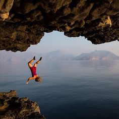 "Rock climber @hazel_findlay ""deep water soloing"", Musandam Peninsula, Oman. Photo: @jimmy_chin. 