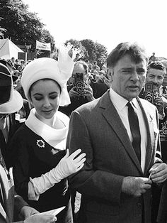 Elizabeth Taylor and Richard Burton in 1963 at the Sandown Park race course in Surrey, England