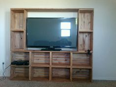 Crate box entertainment center. ... used 12 crates four 1x10 6 foot long still thinking if I want to join the base with 8 crate to the top with four crates.  I have this up stairs so I'm thinking about not joining them to gether any ideas let me no any question on how to build will answer an total cost was under 200 bucks