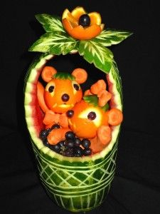 Watermelon basket with tangerine critters