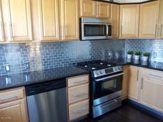#stainless steel #backsplash & #hardwood flooring in this contemporary #Woodlawn Park home