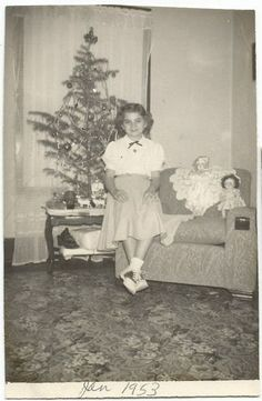 Vintage Christmas photo, Jan 1953 - Love the dolls displayed for the photo and the smile on this girl's face!