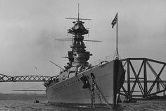 HMS Hood alongside the Forth Bridge 1920's