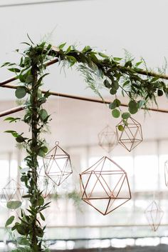 Copper, greenery and geometric shapes make the prettiest combo for a ceremony arch.