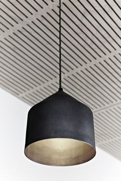 awesome Great matte black pendant w/ metallic interior. Not to mention a cool ceiling....