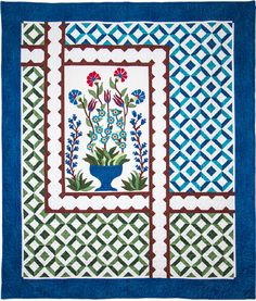 """Amador Valley Quilter's Opportunity Quilt for 2016-2017 is called """"Turkish Delight"""".  The lovely quilt, reminiscent of ceramic Turkish tiles, was inspired by  several quilts in the book Constantinople Quilts by Tasmin Harvey.  Julie Colburn designed the final version of the quilt."""