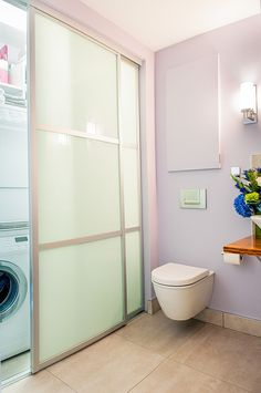 Sleek laundry and bathroom combination makes perfect use of space - Decoist