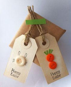 Happy Easter tags- bunnies & carrots - greeting gift tag -party favor tags (set of 6// 3 of each) Happy Easter tags are designed with a bunny rabbit and a carrot motif. These are perfect to embellish your favors and gift bags for everyone. Following is the detailed description of the tag: Come in a set of 6 Measures: 2.65 x 1.375 (xsmall) acid free tag Hand dyed in organic black tea Handstamped with acid- free ink Embellished with buttons Tags are stamped happy Easter on the back Tags a