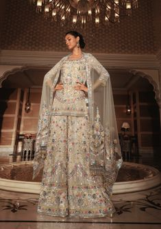Our eclectic Kashmiri Kalidar embroidered in scalloped floral artwork and bright sequins paired with electric blue palazzos is your sartorial chic summer statement.   Manish Malhotra Manish Malhotra, Floral Artwork, Electric Blue, Sequins, Sari, Bright, Photo And Video, Chic, Summer