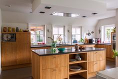 The warm kitchen is a mix of country and modern. Just perfect for a modern farmhouse.