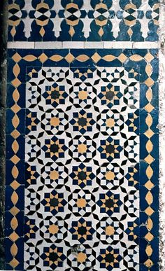 Image MOR 0324 featuring decorated area from the Attarine Medersa, in Fez, Morocco, showing Geometric Pattern using ceramic tiles, mosaic or pottery.