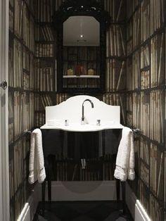 Fornasetti Ex Libris Cole & Son wallpaper in bathroom.