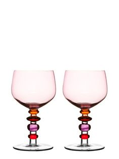 Soft pink shades lend a designer touch to this perfect pair of wine glasses, which feature multi-color decorative stems. Set of 2 Spectra wine glasses. Style # at Lamps Plus. Colored Wine Glasses, White Wine Glasses, Carafe, Vases, Wine Glass Set, Red Candy, Pink Tone, Pink Purple, Hot Pink
