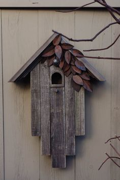 This birdhouse is made from reclaimed barn wood from the Pacific Northwest. Its natural aged finish has been preserved. This birdhouse is