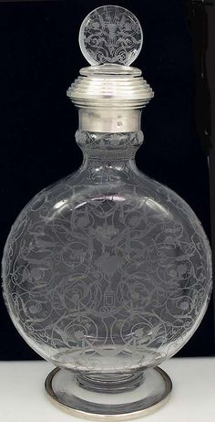 "French Etched Decanter with Silver Bands -  pull out stopper is etched with a fine pattern on the front and back of the circular body. There is a hallmarked French silver collar around the neck and around the edge of the base.  Extremely fine detail. 10 3/4"" tall."