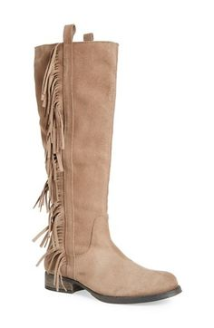 An alluring knee-high boot composed in soft suede is ampedup with side fringe and a burnished round toe.