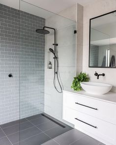 Showerhead; shower niche shape; black hinged glass; black framed mirror; basin shape; cabinet handles. Dislike other tapware.