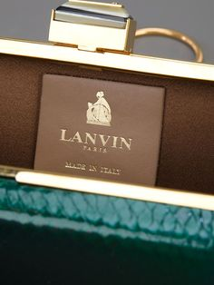 Lanvin 'beyond' Box Clutch - Rio Store - Farfetch.Green python skin box clutch from Lanvin featuring a gold-tone metallic trim and tonal grey stone clasp fastening to the top, a chain mail shoulder strap and a beige lining. Measurements: strap: 50 centimetres, height: 9 centimetres, depth: 4 centimetres, width: 15 centimetres $1036