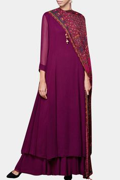 Featuring a wine color embroidered dori neck georgette long kurta. It comes along with a pair of matching georgette palazzo pants and a digitally printed dupatta highlighted with sequin work all over. Fabric: Georgette Care Instructions: Dryclean only.
