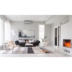 Woodnotes Avenue paper yarn carpet in the living room. Interior design inspiration. Nordic and Scandinavian style.