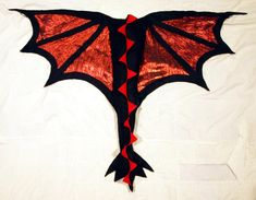 Free shipping on domestic orders! (United States) International orders welcome! These dragon wings are for people of all ages who want to be Dragons! Fully ready to wear and flap, run, and jump around anywhere and everywhere! The main material is felt with sheer fabric for the in between spaces of the wings. Great for Halloween, parties, birthday gifts, and most importantly playtime any day of the year! Black and red are two of my favorite colors and they look great together as dragon wings…