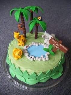 Here is a cake that I decorated for my nieces 1st birthday.  I used fimo for the animals / trees as I wanted her to be able to keep them as a keepsake.   Thanks to everyone for inspiring me with their jungle themed cakes!    My brother made the chocolate mud cake and iced it with white chocolate (green) ganache / fondant leaves.