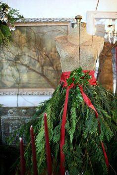 Lovely fresh cedar bough skirt on mannequin. Great display for Greens Table at Christmas Fair.
