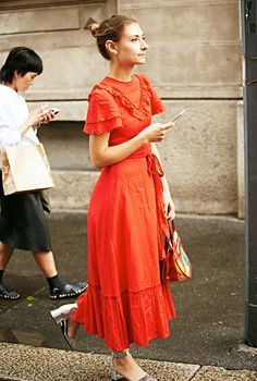 Le Fashion Blog Street Style Messy Bun Long Red Ruffled Dress Handbag Metallic…