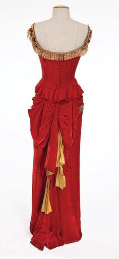 """Renee Hubert Betty Grable """"Winifred Jones"""" red velvet beaded dress from The Beautiful Blonde from Bashful Bend  Red velvet dress with gold lamé shoulder straps and elaborate gold bugle bead design on the chest, along the skirt and fringe."""