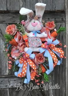 Easter Floral Wreath, Spring Wreath, Spring Decor, Spring Door, Bunny Wreath, Bunny Swag, Bunny Decor, Easter Wreath, Easter Swag, Easter Decor Gorgeous Orange, Blues & Greens make for a Stunning Easter Masterpiece! Dainty florals, roses in bloom, an assortment of lush greens and