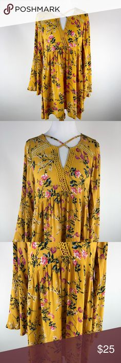 Giddy Up Glamour Medium Yellow Floral Tunic Dress Giddy Up Glamour Medium Yellow Floral Tunic Dress boho criss criss v neck bell sleeves. Used in great condition with no flaws.  Pit to pit= 22  Under arm to end of sleeve= 18.5 Length= 30 D31 giddy up glamour Dresses Mini