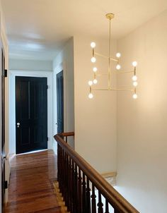 My Entryway and Stairs: The Big Reveal! Restoring Old Houses, Manhattan Nest, Wall Molding, Moldings, Entryway Stairs, Mid Century Chandelier, Rose House, Faux Granite, Trim Work