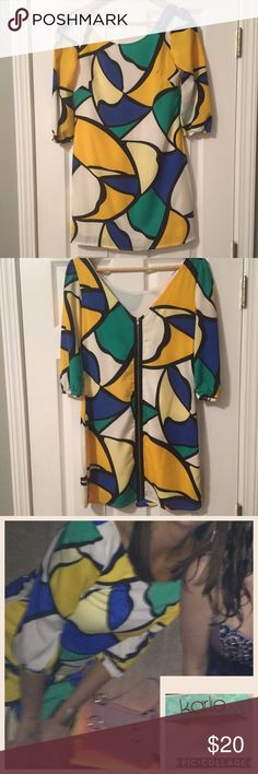 Karlie Dress Karlie Dress- white, black, yellow, green, blue-v in back with exposed zipper- 100 poly- lined- a couple of stains on back bottom of dress (see photos)- not super noticeable- not as boxy as appears in photo-only worn once to bachelorette party Karlie Dresses