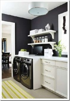 Bold black and white utility room. Notice the white glazed cabinets. Still white, they coordinate with the black. I hope this helps with yours! @Amy Huntley (The Idea Room)