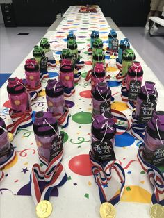 Gymnastics birthday party favors! Dollar tree water bottle + instruction sheet on how to do a handstand + chocolate coin medal (ribbon + chocolate coin + hot glue gun) = kiddos loved it!