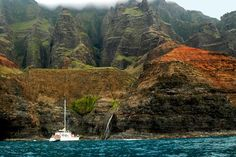 Kauai Photos at Frommer's - Boat gets close to small waterfall off the rugged coast of Na Pali on the Island of Kauai, Hawaii