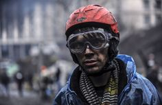 A protestor stands near barricades during clashes with riot police in central Kiev, on February 20, 2014. (Bulent Kilic/AFP/Getty Images)