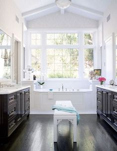 gorgeous bathroom.  love the placement of the bench.  love the hardwood floor color