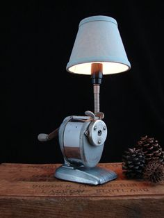 I can just hear the sound of and feel the motion of this old Boston pencil sharpener...upcycled into a lamp :-)
