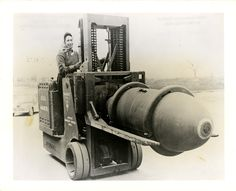 Great photo: Louise Lincoln transporting a bomb on a #forklift.