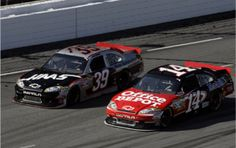 Ryan Newman (#39) and Tony Stewart (#14) of SHR race for the flag with the aid of FDM parts.
