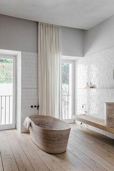 A STUNNING FREE STANDING STONE BATHTUB