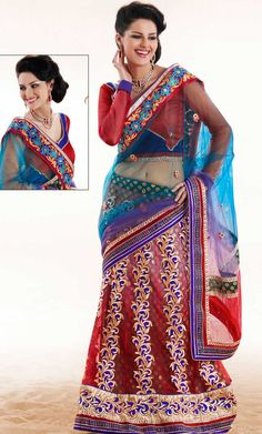 Dreamy variation on shape and forms compliment your style with tradition.   This blue and shaded red net lehenga style saree is nicely designed with embroidered patch work is done with resham, zari, stone and lace work.   Beautiful embroidery work on saree make attractive to impress all.   This saree gives you a modern and different look in fabulous style.   Matching blouse is available.   Slight color variations are possible due to differing screen and photograph resolution.