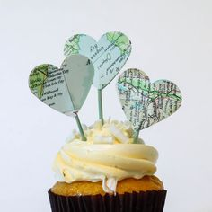 Hand punched hearts from vintage world atlas maps are carefully added to a dyed toothpick to add a fun custom party decor for your event.  Yup, we