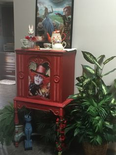 This is a 1929 majestic highboy radio( with Bluetooth speaker inside)  fully painted with Dixie Belle barnyard red and flamingo and legs are done in  Annie Sloan duck egg blue . The mad Hatter Gracefully adorns the centerpiece and the interior is done in graphite Grey. Ty for looking 😉🌹